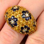 A yellow sapphire, sapphire and diamond floral bombé ring, by Jean Vitau.