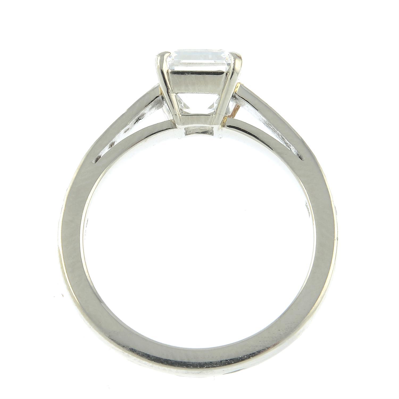 A platinum rectangular-shape diamond single-stone ring, with brilliant-cut diamond line shoulders. - Image 5 of 8