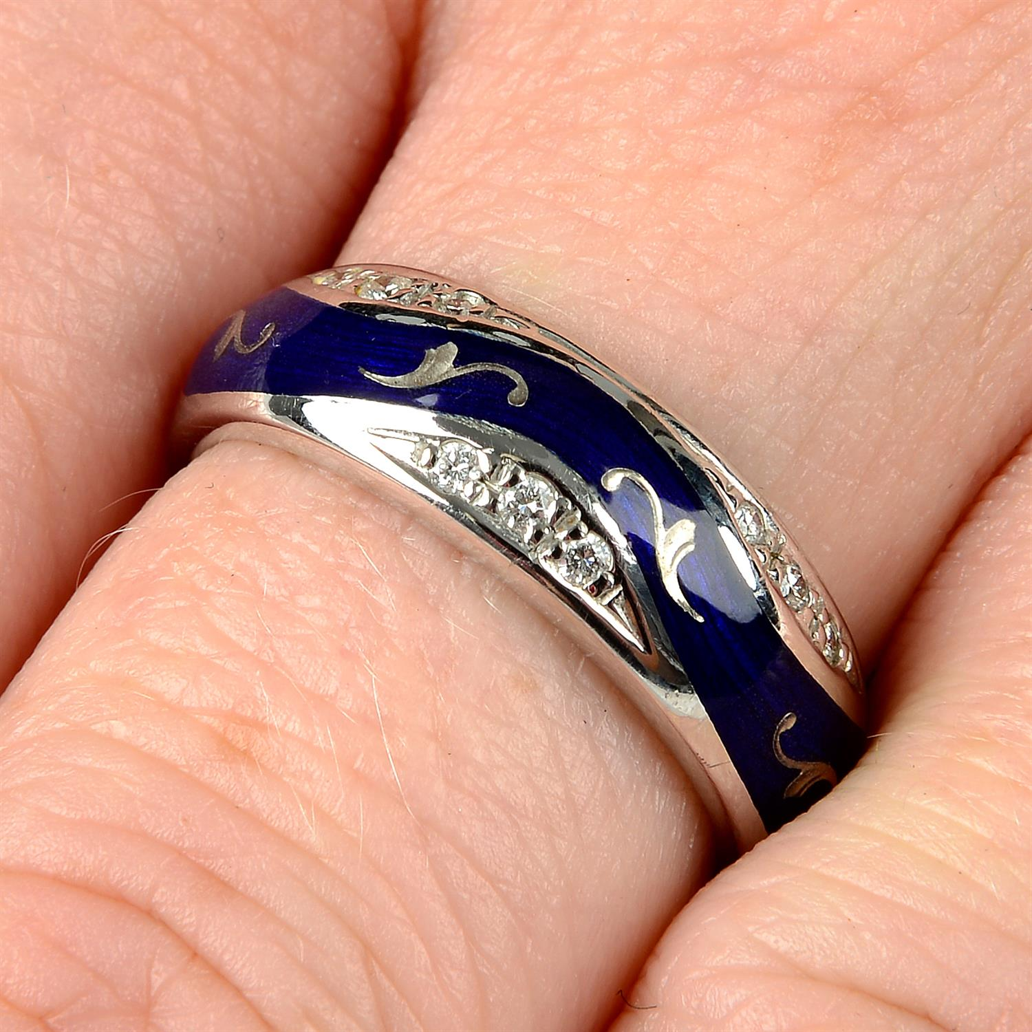 A limited edition 18ct gold diamond and blue enamel ring, by Fabergé.