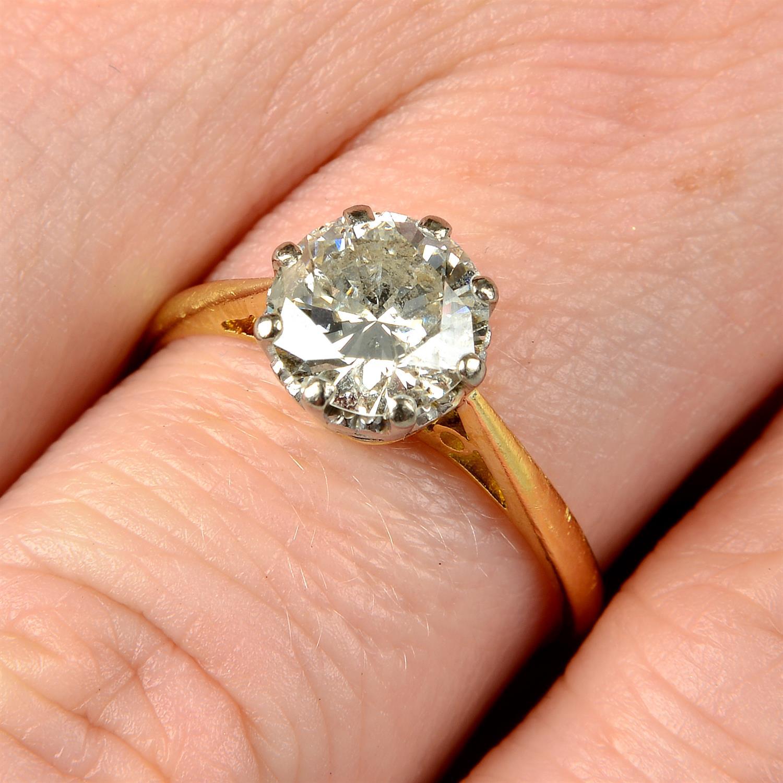 An 18ct gold brilliant-cut diamond single-stone ring.