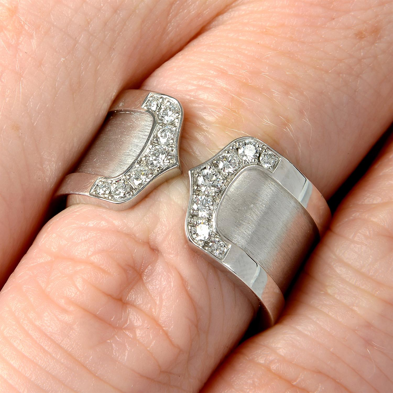 A diamond 'C de Cartier' ring, by Cartier.