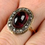 A garnet and rose-cut diamond cluster ring.