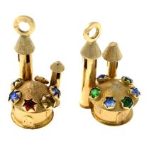 Two castle charms, each with vari-hue paste highlights.