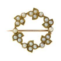 An early 20th century gold split pearl wreath brooch.