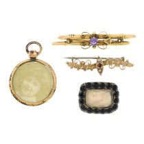 Three early 19th and early 20th century brooches and a pendant.