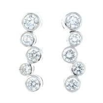 A pair of 18ct gold brilliant-cut diamond drop earrings.