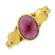 An 18ct gold garnet single-stone ring.