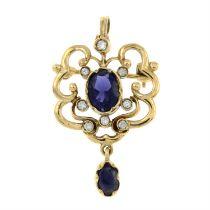 A 9ct gold iolite and brilliant-cut diamond pendant / brooch.