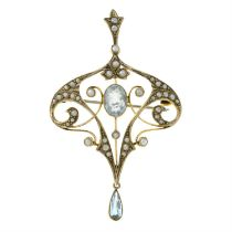 An early 20th century 9ct gold aquamarine and seed pearl pendant.