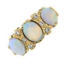 A 1980s 9ct gold opal cabochon and brilliant-cut diamond dress ring.