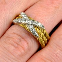 A rope-twist band ring, with pavé-set diamond cross highlight.