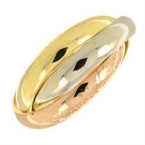 A 'les must de Cartier' trinity ring, by Cartier.