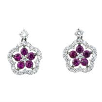 A pair of brilliant-cut diamond and ruby floral drop earrings.