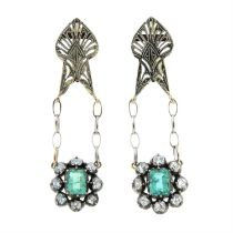 A pair of earrings, suspending a late 19th century emerald and old-cut diamond cluster.
