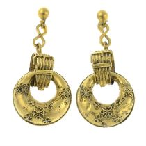 A pair of late 19th century gold drop earrings, with cannetille detail and buckle motif.