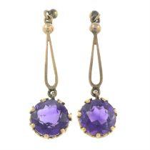 A pair of amethyst drop earrings.