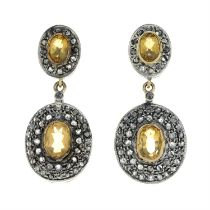 A pair of citrine and diamond earrings.