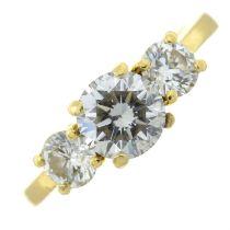 A brilliant-cut diamond three-stone ring.