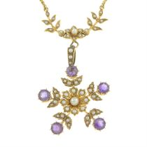 An early 20th century 15ct gold seed and split pearl necklace, suspending a detachable amethyst,