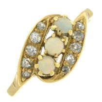 An opal and diamond crossover dress ring.