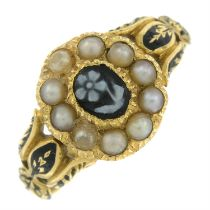 A mid Victorian gold carved agate, split pearl and enamel mourning ring, depicting a