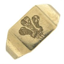 A 9ct gold signet ring, carved to depict Prince of Wales's feathers.