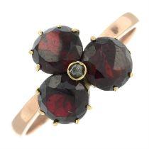A garnet and rose-cut diamond trefoil cluster ring.