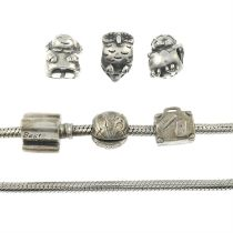 Two bracelets, together with twenty-two charms, by Pandora.