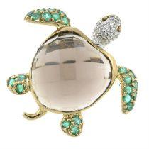 A 9ct gold smoky quartz, emerald and diamond turtle ring.