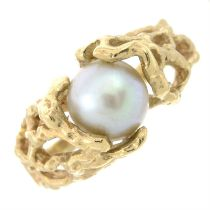 A cultured pearl dress ring.