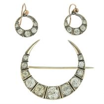 A set of paste crescent jewellery, to include a brooch and a pair of earrings.