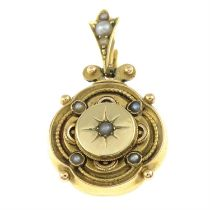 A late 19th century gold pendant, with split pearl accents.
