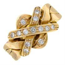 A circular-cut diamond four-band puzzle ring.