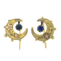 A pair of early 20th century 9ct gold bi-colour crescent earrings, each with blue paste accent.