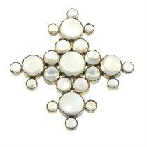 A moonstone brooch.