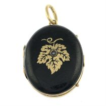 An early 20th century black enamel locket, with split pearl accent.