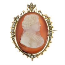 An early 20th century gold carnelian cameo and split pearl brooch, carved to depict a gentleman in