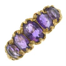 A 9ct gold amethyst five-stone ring.