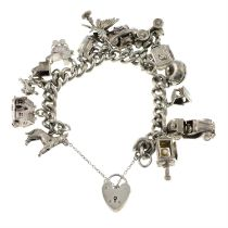 A silver curb-link charm bracelet, suspending fourteen charms, gathered at a heart-shape padlock