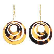 A pair of tortoiseshell drop earrings.
