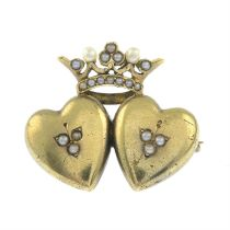 An early 20th century gold double-heart and crown brooch, with seed and split pearl accents.