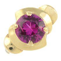 A ruby dress ring.