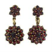A pair of garnet cluster drop earrings.