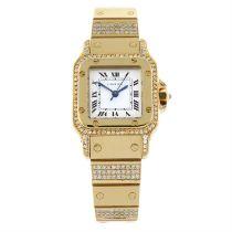 CARTIER - a yellow metal Santos bracelet watch. 24mm.