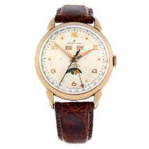 BREITLING - a rose metal Datora triple date moonphase wrist watch, 35.5mm.