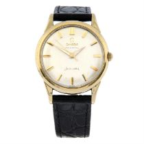 OMEGA - a gentleman's yellow metal Seamaster wrist watch, 33mm.