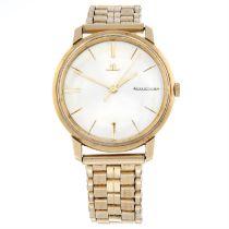 JAEGER-LECOULTRE - a 9ct yellow gold bracelet watch, 33mm.