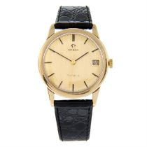 OMEGA - a 9ct yellow gold Geneve wrist watch, 33mm.