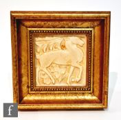 A 1950s framed Marsden 4in dust pressed tile, intaglio molded with a stag, the design attributed