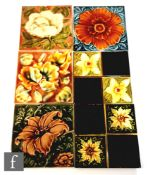 Six assorted early 20th Century Art Nouveau 6in dust pressed tiles with raised floral decorationm to